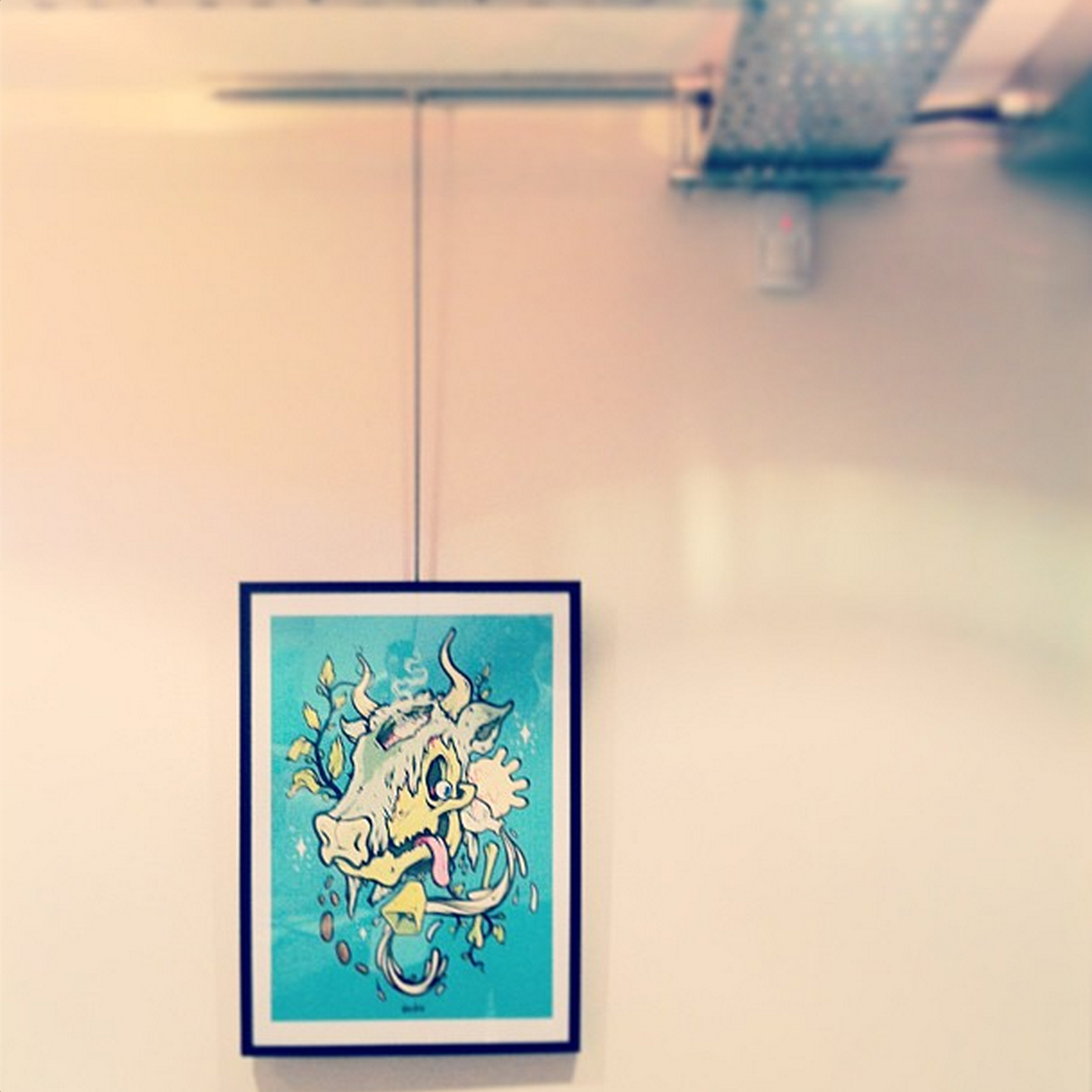 Dan Leo print hanging in the basement of Timber Yard